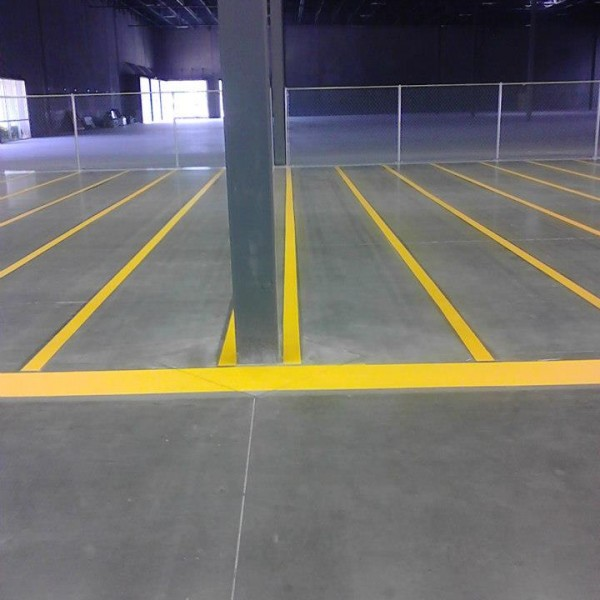 Yellow painted lanes inside a Stripe-a-Zone client's warehouse.